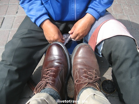 Getting a shoe shine in the Parque Central de Miraflores, Lima, Peru