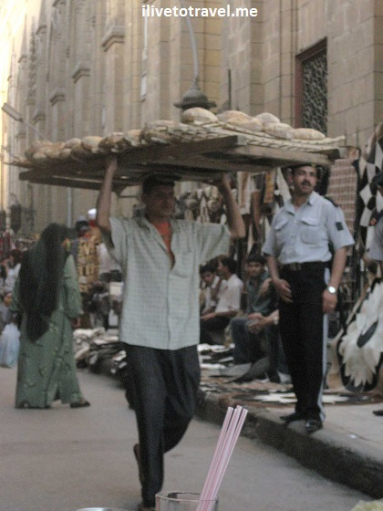 Taking bread from the bakery around Khan el-Khalili in Cairo, Egypt