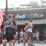 The American flag is carried by a runner on the 4th of July's Peachtree Road Race in Atlanta