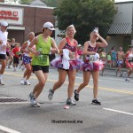 Happy runners show their spirit on the 4th of July at the Peachtree Road Race in Atlanta