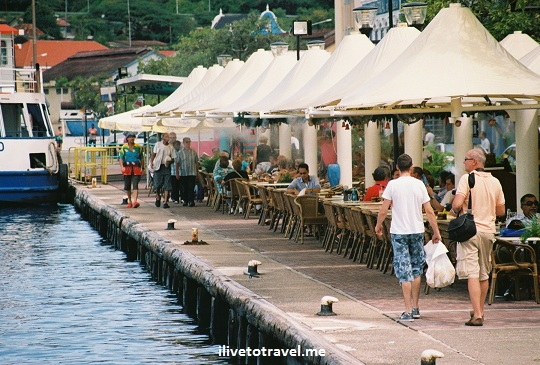 Waterfront cafes and restaurants in Willemstad in Curacao by the entrance to the bay