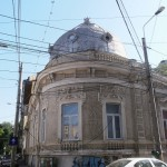 Overhead cable maze blocks beautiful building in Bucharest, Romania