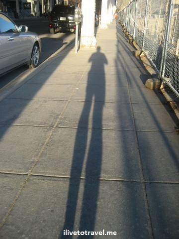 Runner shadow ona sidewalk at sunset