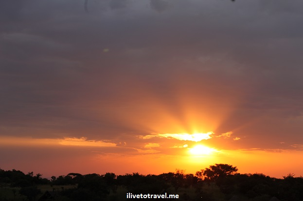 Sunset over the Serengeti in Tanzania while on safari - a fiery sky