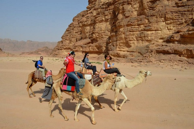 "Riding camels ""Wadi Rum"" desert Jordan outdoors adventure travel photo"